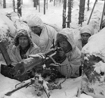 Finnish soldiers manning foxhole during Winter War